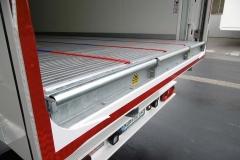3 Achs Sattelauflieger mit Sandwich Kofferaufbau, automatischen Rolltor für maximale Durchladebreite mit einem Lamellenbandsystem von Cargo Floor 2  (1)