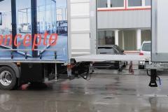 Gliederzug mit Druchladesystem über längenverstellbares Zugrohr und der Ladebordwand des LKWs, Aufbau mit Schiebespannplanenaufbau (1)